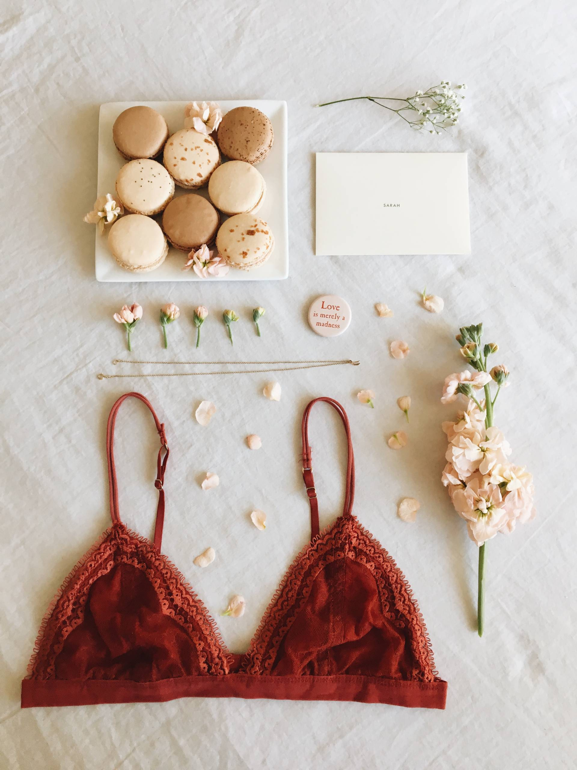 Ginger Elizabeth macarons, flowers, and an Urban Outfitter's bralette