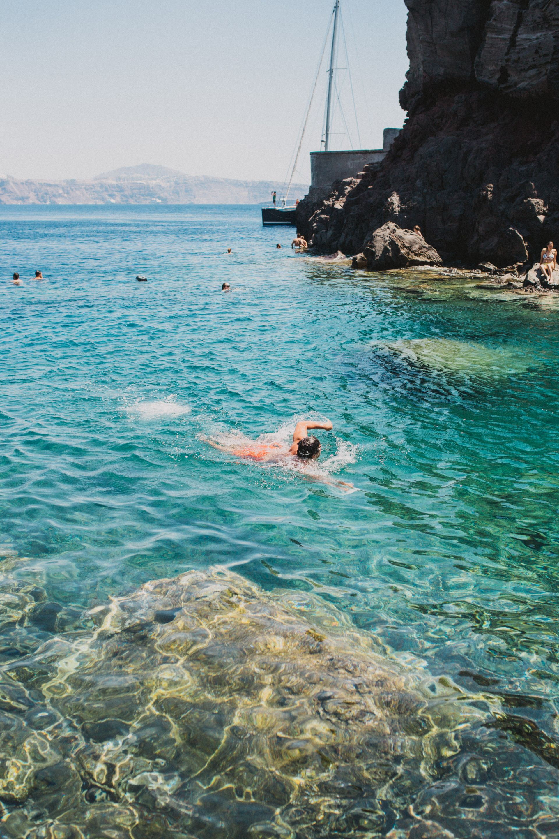 Cliff Jumping in Ammoudi Bay, Oia, Summer in Santorini | SarahMichiko.com
